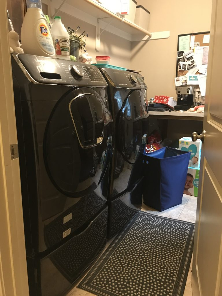Image of laundry room with front loading washer and dryer