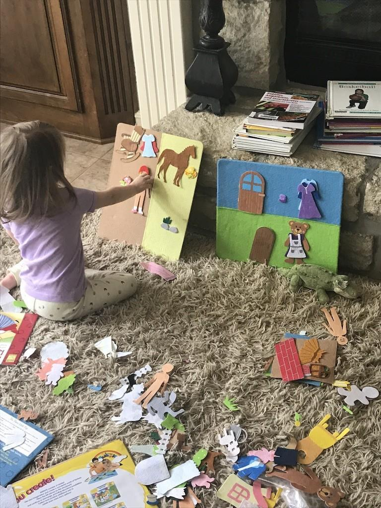 Little girl playing with felt board