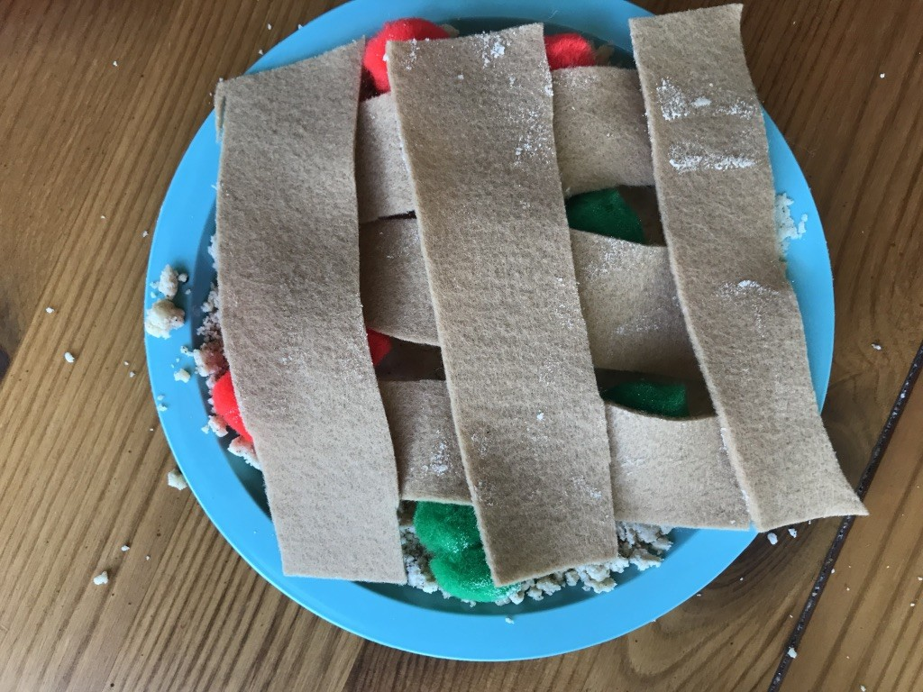 Apple pie from preschool play made with dough, felt, and pom moms. Part of a letter and apple unit.